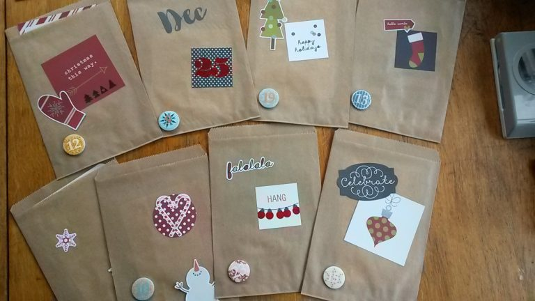 Use christmas embellishments to decorate the bags for your diy advent calendar